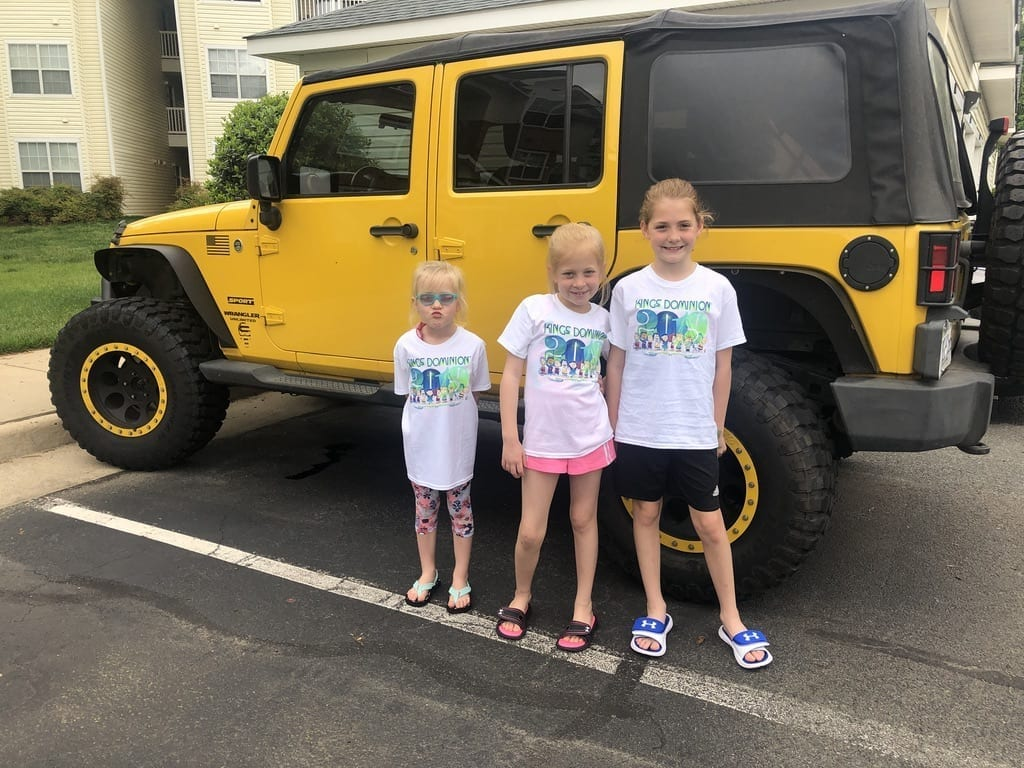 Daughters infront of yellow Jeep